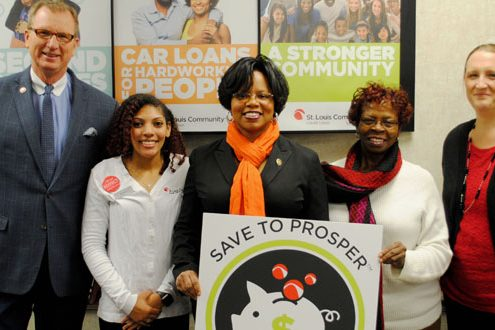 "People smiling and holding a sign stating, ""Save to Prosper"""