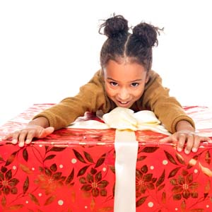 Girl holding onto large present